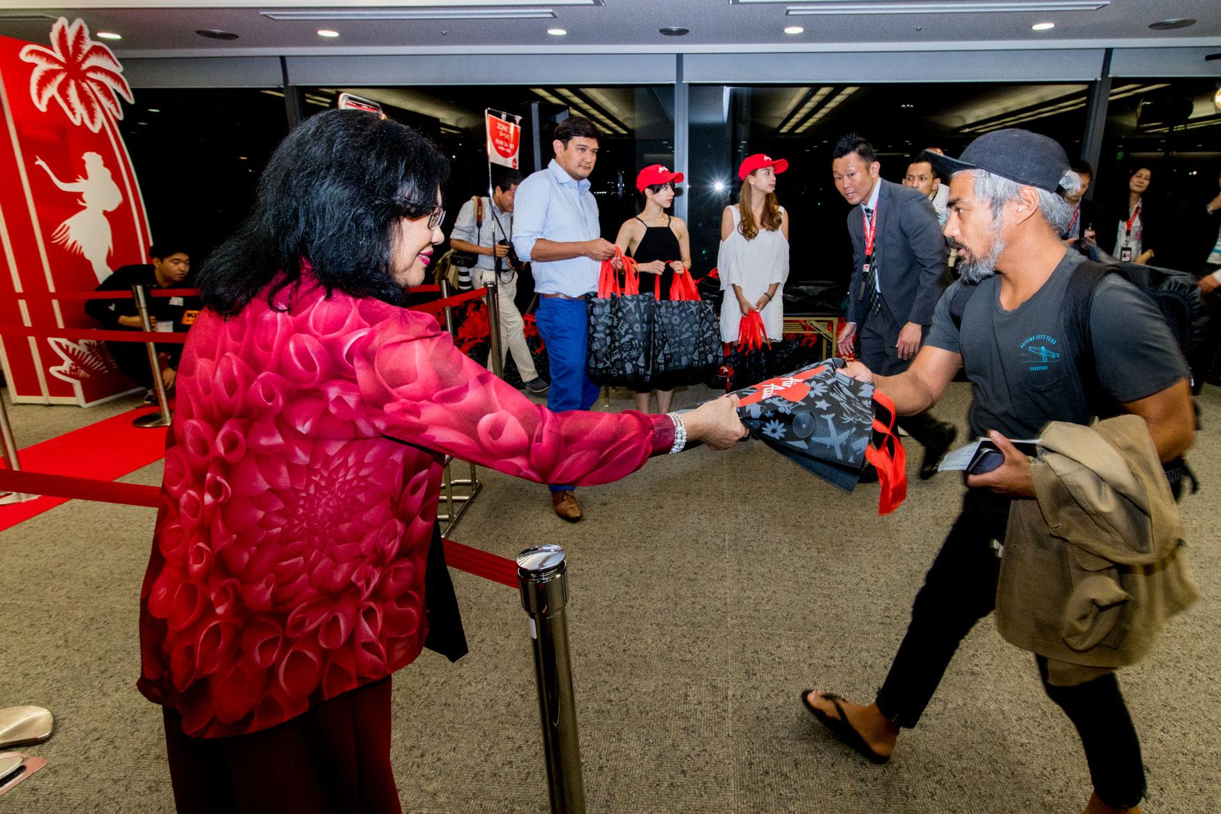 AirAsia X Chairman Handing Out Gift Bags
