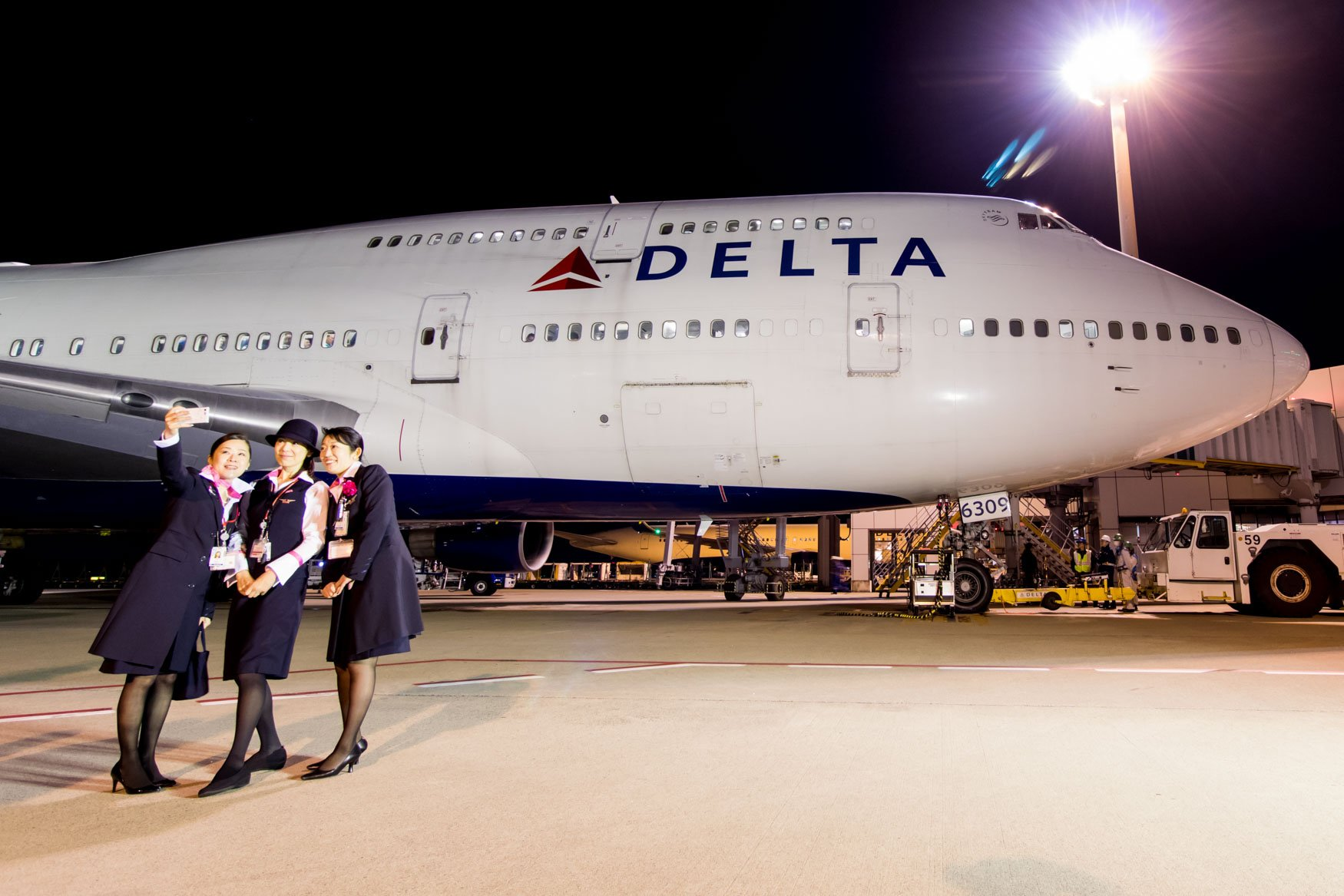 Staff Posing with Delta 747