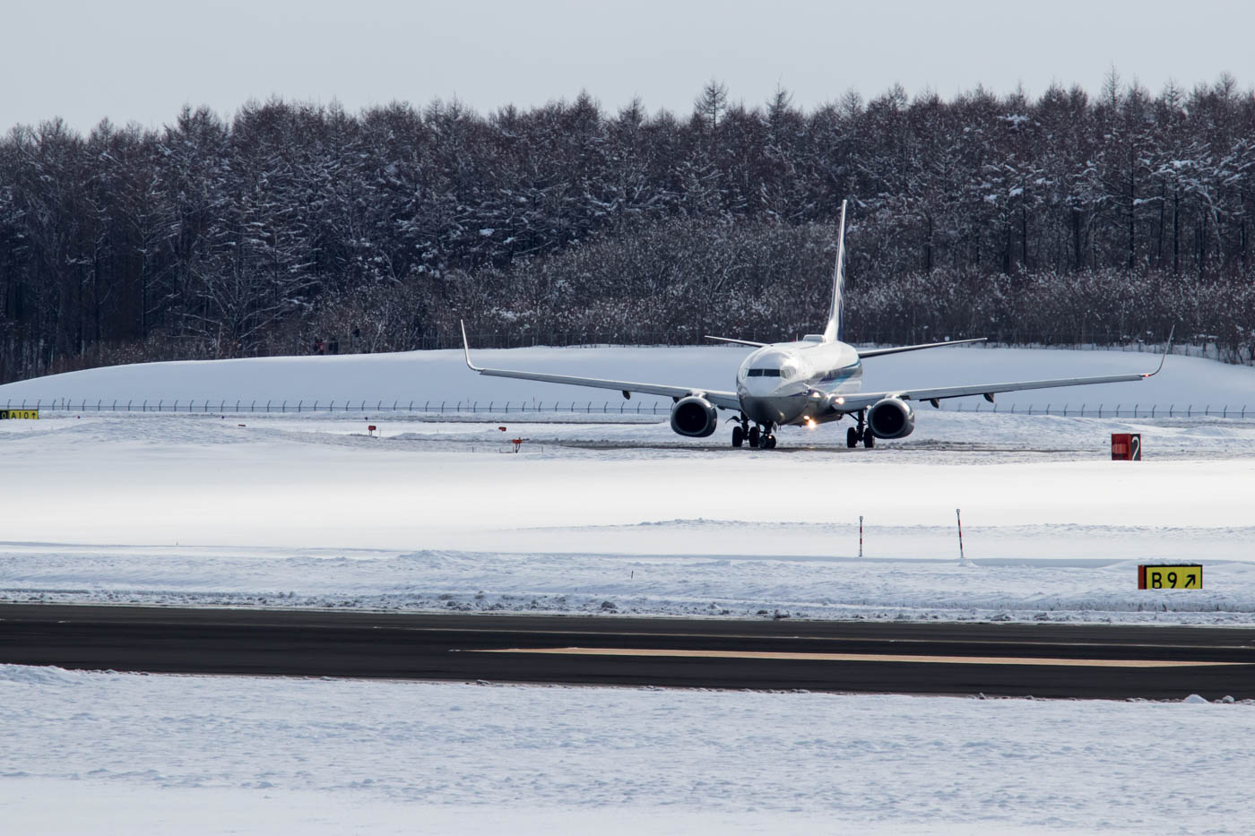 ANA 737 Lining Up for Departure from Snowy Sapporo